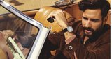 Drive de Cartier watch, Dhs21,900, Cartier; Santos de Cartier, sunglasses, Dhs1,480, Cartier; leather jacket, Dhs7,365, and jumper, Dhs1,760, both dunhill.