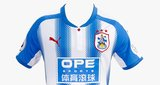 Huddersfield Town - The 2017/18 season will be Huddersfield's first season in the top flight after a 45 year absence. If this kit is anything to go by then we sincerely hope they aren't in the Premier League for at least another 45. Ghastly. 2/10