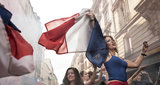 As the referee whistles the end of the game French supporters celebrate Frances victory against Croatia in 2018 World Cup final on Daguerre street on July 15 2018 in PARIS France