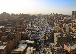 Artist eL Seed cleans up Cairo's 'Garbage City'