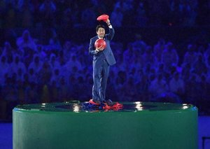 Yes, the Japanese Prime Minister jumped out of a pipe dressed as Mario