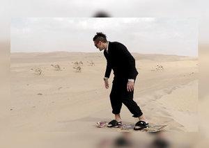 Esquire takes Casey Neistat sandboarding in the Dubai desert