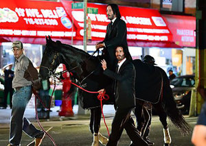 See Keanu Reeves riding a horse through New York