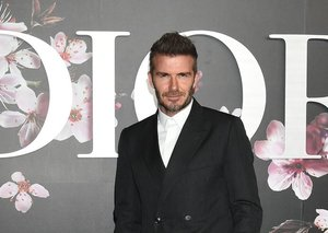 David Beckham has settled the suit v sneakers debate