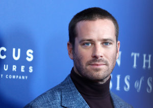 Armie Hammer does slogan jumpers right