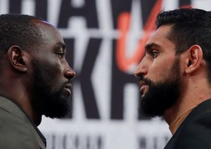 Amir Khan loses WBA title fight to Terence Crawford after low blow