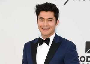 Henry Golding continues to own the tuxedo look