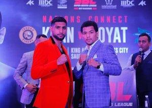 Britain's Amir Khan will fight Indian boxer Neeraj Goyat in Saudi Arabia