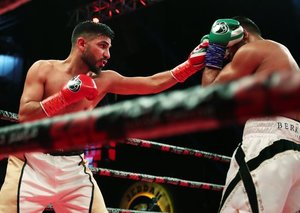 Amir Khan defeats Australia's Billy Dib in Jeddah to win welterweight title