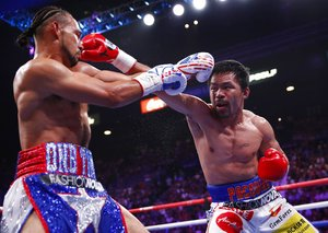 40-year-old Manny Pacquiao knocks down Keith Thurman to win title