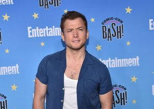 Vests are officially a thing this summer. Just ask Taron Egerton