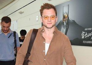 Taron Egerton's tan shirt is perfect airport style