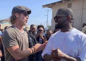 Brad Pitt just crashed Kanye West's Sunday Service performance
