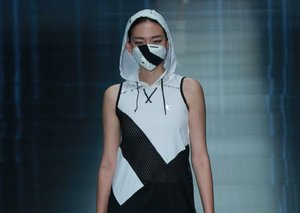 Face masks become Paris fashion week must-haves