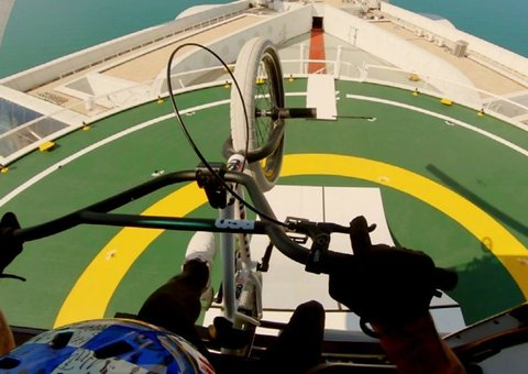 This biker just jumped out of a chopper on to the roof of Dubai's Burj Al Arab hotel