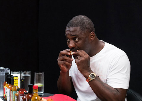 Idris Elba wears the $30,000 watch of your dreams while eating messy hot wings