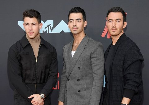 The Jonas Brothers have grown up. So has their red carpet style