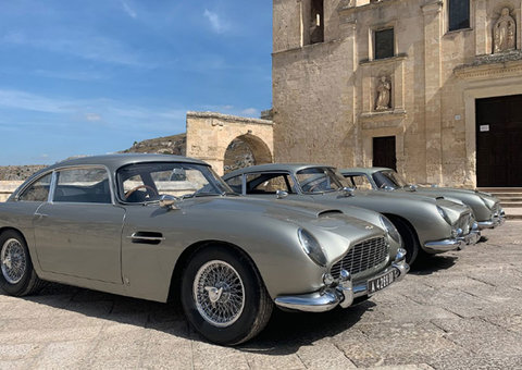 James Bond shows off not one, not two, but three Aston Martin DB5s