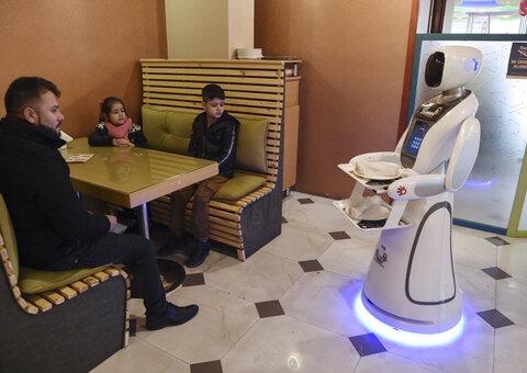 Inside Afghanistan's first robot waitress café