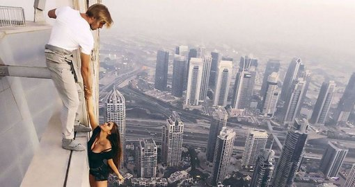 Model hangs unharnessed from 1,000ft building in Dubai