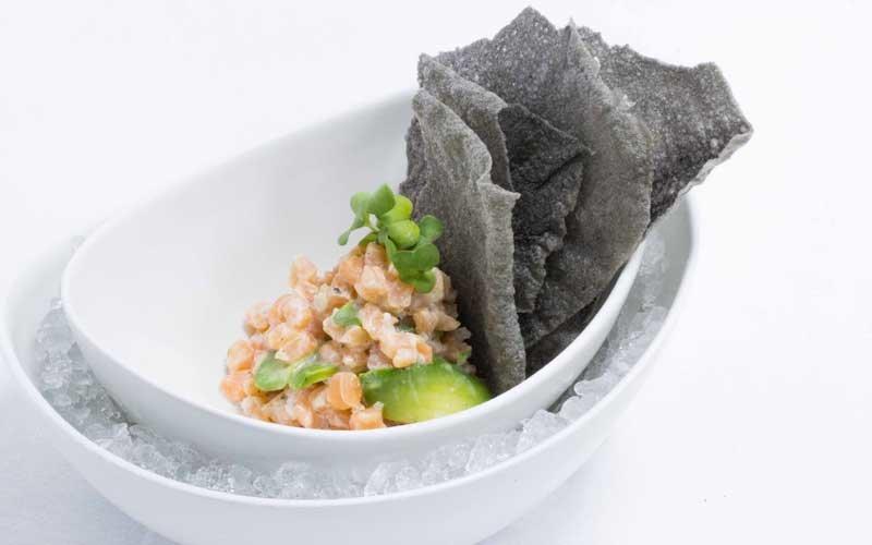 Scottish salmon tartare, avocado, cream fresh and black rice crackers