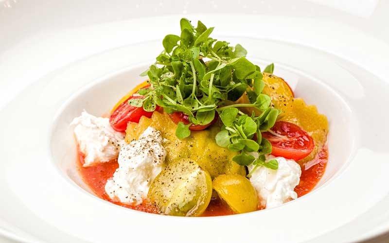Burrata ravioli, ricotta basil cream and cherry tomatoes