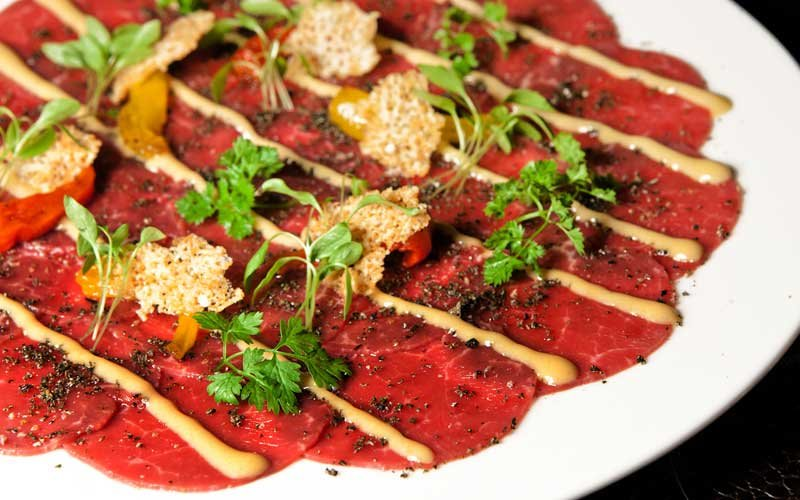 Beef carpaccio, sundried peppers and Dijon mustard mayonnaise