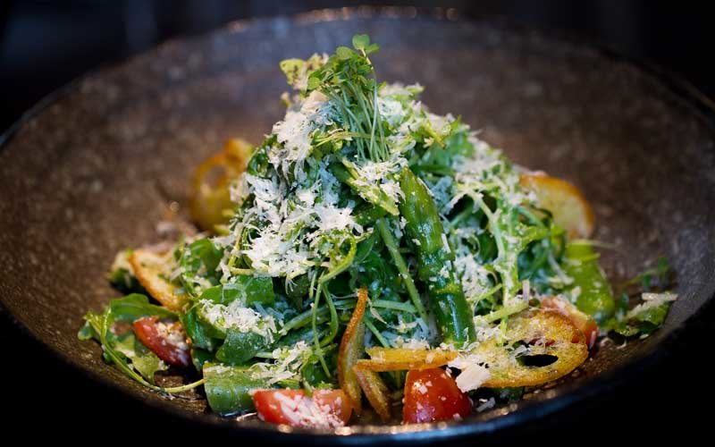 Roquette salad with datterini tomatoes and Parmesan cheese