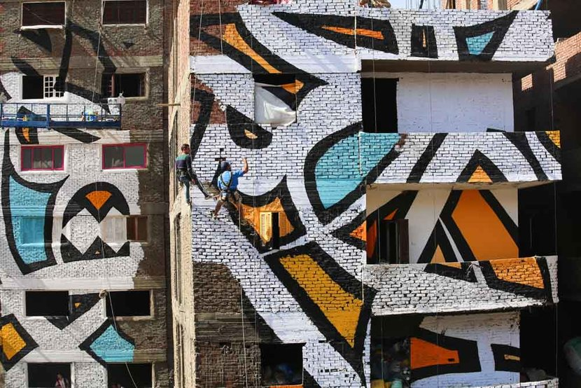 The team spent three weeks painting buildings in the rundown area