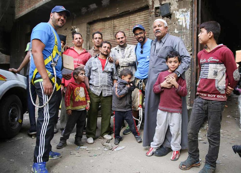eL Seed (fourth from the right) and members of the Zaraeeb community