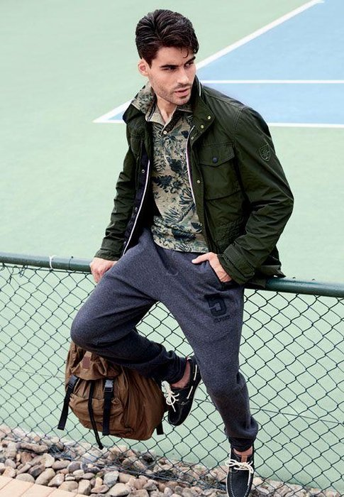 t-shirt, dhs499; jacket, dhs1,899; track pants, dhs599; shoes, dhs599; bag, dhs599, all tommy hilfiger