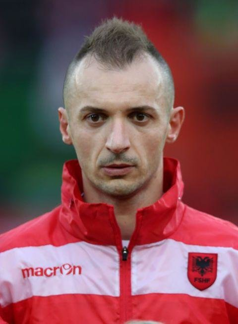 Ansi Agolli  (Albania)  -  There isn't a haircut more feeble and depressing than a desperate, receding mohawk. Let it go Ansi. Let it go.