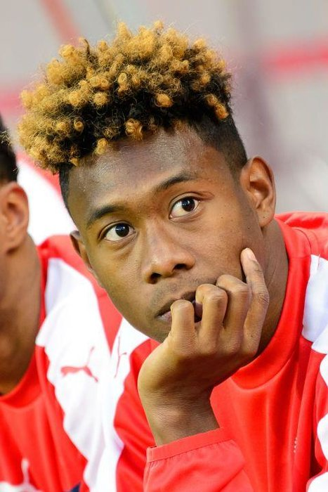 David Alaba (Austria)  -  Footballers have gone mad for the bleached look recently. Unfortunately Austria's David Alaba has taken a strong left and veered straight into ginger Wotsit territory.