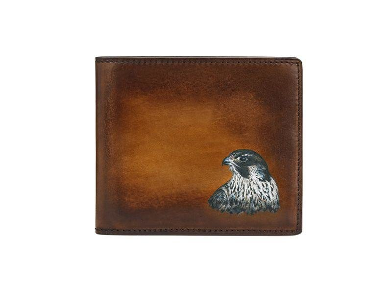 Berluti Wallet - While gifting isn't the traditional custom for Eid, this Makore wallet has been customised with a falcon's head specifically for the Gulf region. Price on Request