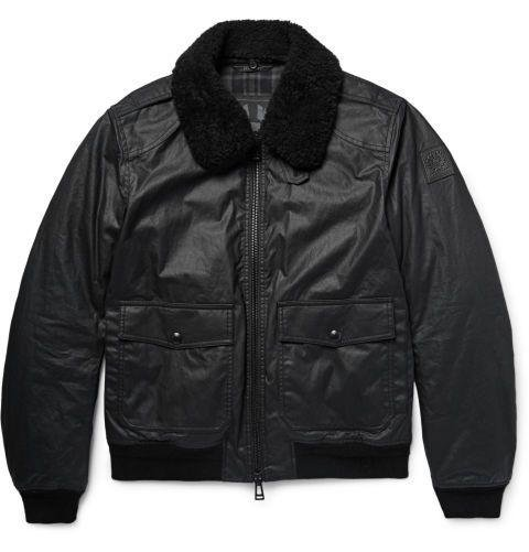 BELSTAFF - MORTIMER SHEARLING TRIMMED WAXED COTTON BOMBER  For a classic, moto-inspired shearling bomber, turn to a classic, moto-inspired brand. Not only is this wax-cotton jacket water repellant and warm, it's also perfect for making people think you just blew in on your Norton Commando. Or maybe you actually did! Who can tell? Dhs3,287. belstaff.com