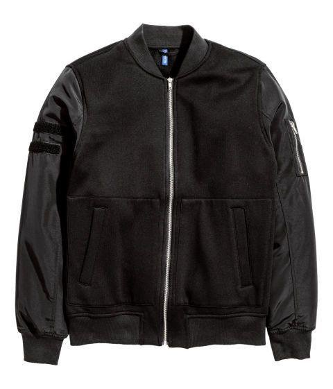 H&M - PILOT JACKET  Go a little goth ninja with this black jersey pilot bomber from H&M. Just keep this in mind: While a pair of Rick Owens Drkshdw sneakers are still a solid move, drop-crotch pants are on the way out. Dhs180. hm.com