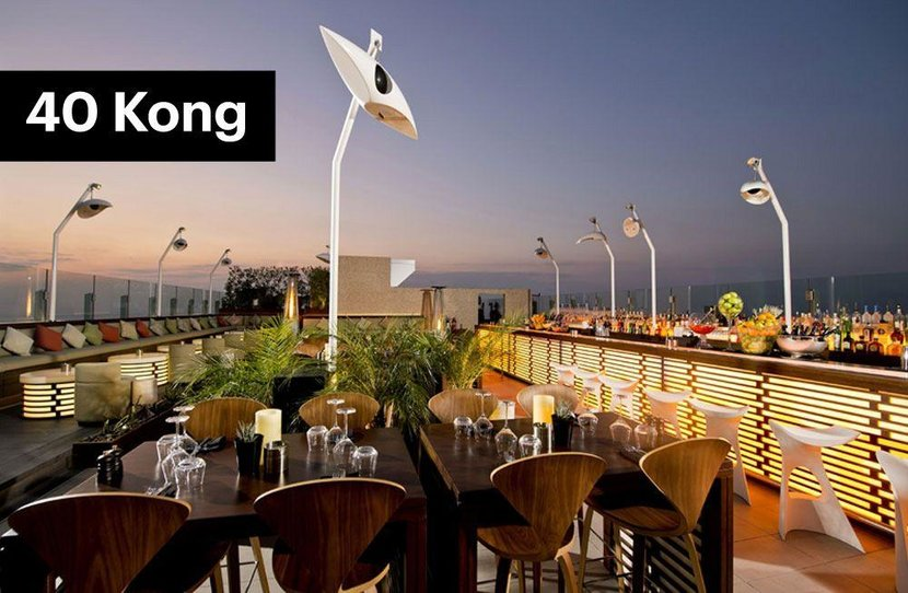 40Kong, The H Dubai  -  Wooden finished, palm trees and rather large fruit bowls - the tiki vibe is strong at 40Kong. But don't be mistaken, this city roof-top bar is anything but ragtag. Located across the road from the Trade Centre, this busy-but-small bar has good vibes, impressive views and talented barmen.