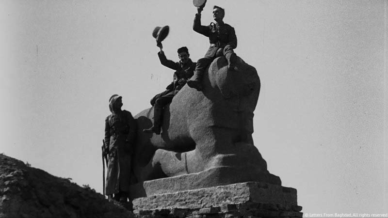 Right: British soldiers atop the Babylon Lion in Babylon,