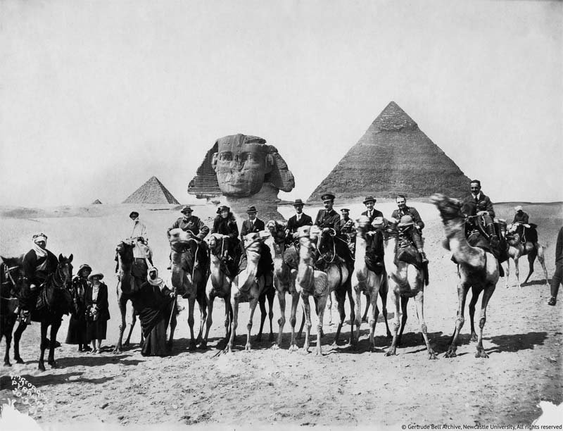 Gertrude Bell, on horseback, seventh from the left (between Winston Churchill and T.E.Lawrence), at the  Cairo Conference, 1921. © Gertrude Bell Archive, Newcastle University.