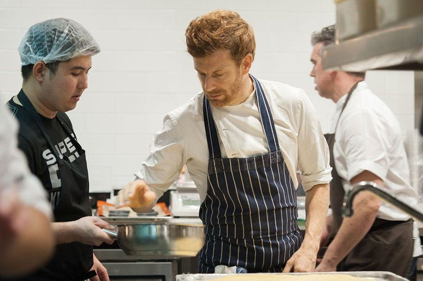 Tom Aiken working with his culinary team