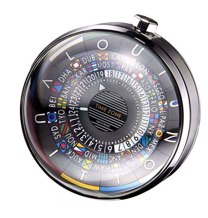 Escale Table Clock, Louis Vuitton [Dhs4,920] - Made of steel, rosewood and glass, this baseball-sized clock displays all 24 time zones at once, and is a 'must' for collectors. louisvuitton.com