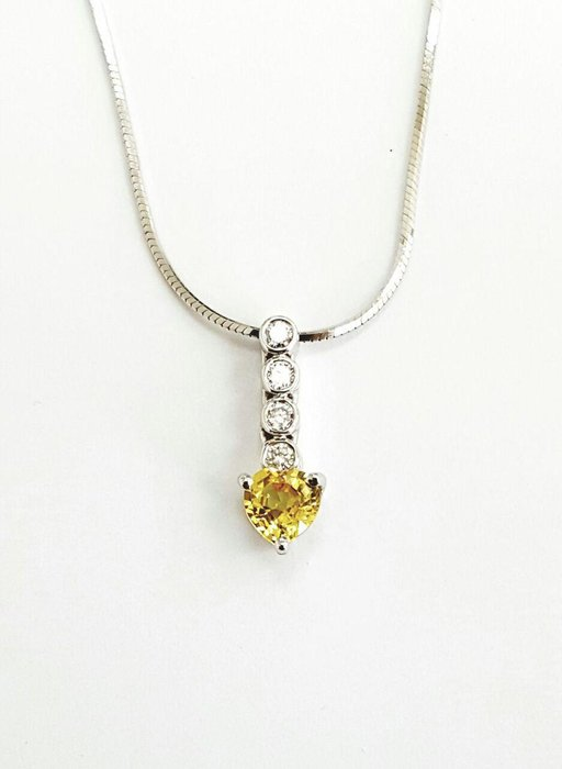 Yellow tourmaline and diamond pendant, Dhs1,650