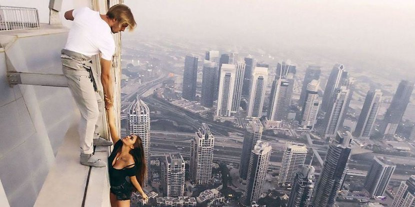 Cayan tower, Hanging, Model, Instagram, Things people do for likes, Model hanging from building, Daredevil, Dubai uae, Crazy, Dubai