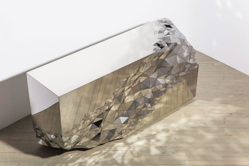 Stella console (2017) by Jake Phipps, presented by Todd Merrill Studio, NYC - Known for a glamorous mix of 20th-century furniture, Todd Merrill Studio makes its Design Days Dubai debut this year with a collection of contemporary design, including this console from its Stellar Collection. Inspired by the precious qualities of machine-cut diamonds, the expansive surfaces on the table are in stark contrast to the turbulent seam of individually sized and angled mirrored sections that run through them.