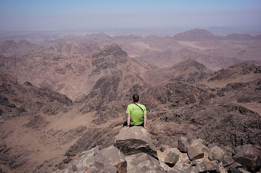 A tourist sits on the edge of Mount Katherine in the mountains of South Sinai. Photo by David DegnerGetty Images