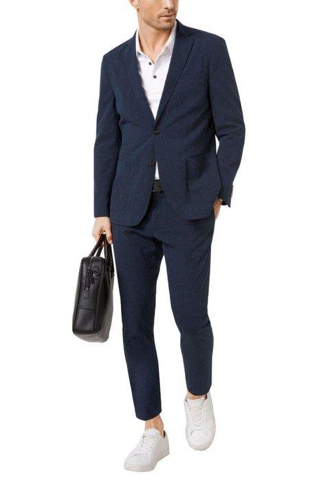 MICHAEL KORS  -  Seersucker Cotton Blend Suit  -  The stripes on this cotton-blend seersucker jacket and trousers are tonal, so you won't feel like a barbershop pole. michaelkors.com