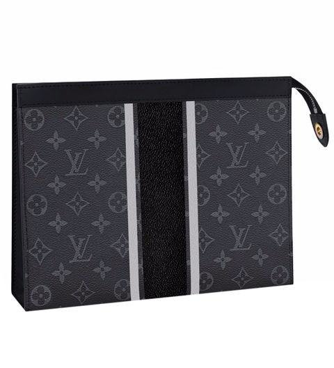 A LEATHER BAG - This pochette (basically an envelope-shaped bag) is part of the Louis Vuitton/Fragment collaboration. It can double as either a portfolio, or a catchall within a bigger bag. Pochette Voyage MM by Louis Vuitton, louisvuitton.com