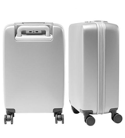 A MODERN SUITCASE  -  Dads love efficiency. This sleek, USB-ported carry-on is exactly that. A22 Carry by Raden, raden.com