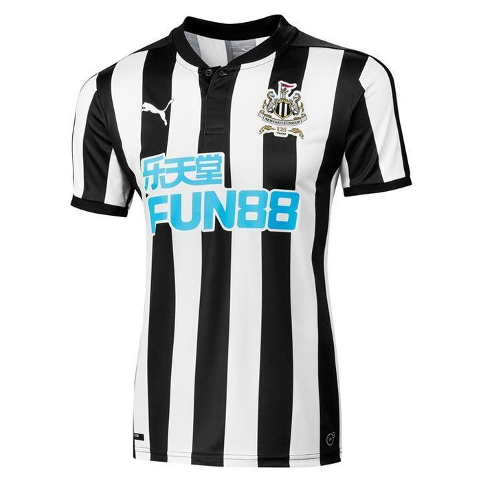 Newcastle - Manchester take note, this is how you do buttons right. And if you ignore the massive, horrible, eye-sore of a sponsor this kit would be a solid 9/10. With it, it's unfortunately a less-than spectacular 6/10.
