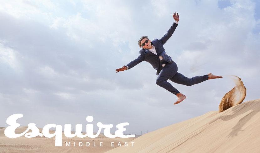 Casey Neitstat leaps off a sand dune in the Dubai desert